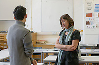 Talking with a staff member, Open Day at Kingston College when prospective students and their parents look around.