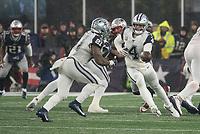 FOXBOROUGH, MA - NOVEMBER 24: Dallas Cowboys Quarterback Dak Prescott #4 hands the ball to Dallas Cowboys Runningback Ezekiel Elliott #21 for a run during a game between Dallas Cowboys and New England Patriots at Gillettes on November 24, 2019 in Foxborough, Massachusetts.