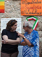 """Ada Colau (Barcelona) & Alex Zanotelli.<br /> <br /> Riace (Calabria, Italy), 04/08/2018. Visiting Riace for the third day of the """"Riace in Festival"""", 'Festival delle Migrazioni e delle Culture Locali' (Festival of Migration and Local Cultures). Attending the festival, amongst others, were the Mayor of Napoli Luigi De Magistris and the Mayor of Barcelona Ada Colau, debating with the Mayor of Riace, Domenico 'Mimmo' Lucano, about the so called """"migration crisis"""", as well as the now famous """"Modello Riace"""" (The Riace Model: how to welcome and work with Migrants to invest in building a future together). Other speakers included: Tiziana Barillà, Journalist at """"il Salto"""" (1) and Author of the book """"Mimi Capatosta. Mimmo Lucano e il modello Riace"""" (2),  Magistrates Riccardo De Vito and Emilio Sirianni (in turn President and Member of Magistratura Democratica). Chair of the event was Ilaria Bonaccorsi, Historian & Journalist at """"il Salto"""".<br /> From the Festival website: """"RIACE in FESTIVAL, is an event born in the wake of the policy of reception and resettlement of refugees and asylum seekers that the city administration of the """"Riace Bronzes'"""" town has been implementing for years. [...] The festival aims to be a concrete initiative that, through the universal language of cinema and the arts, promotes the exchange and mutual knowledge to counteract forms of closure and racism, drawing attention to the innovative path that the municipal administration of Riace has started by combining the reception of migrants with the revival of its territory and giving the image of an unpublished Calabria, different from that of the black chronicle>>.<br /> Riace is a small village in the province of Reggio Calabria. It's famous because on the 16 August 1972 Stefano Mariottini, a chemist from Rome, found two full-size Greek bronzes... (Riace Bronzes: https://bit.ly/2oBoFNY)<br /> (For the full caption read the ARTICLE at the the beginning of this story)"""