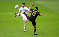 LOS ANGELES, CA - OCTOBER 25: Sebastian Lletget #17 of the Los Angeles Galaxy battles with Mohamed El-Munir #13 of the Los Angeles FC during a game between Los Angeles Galaxy and Los Angeles FC at Banc of California Stadium on October 25, 2020 in Los Angeles, California.
