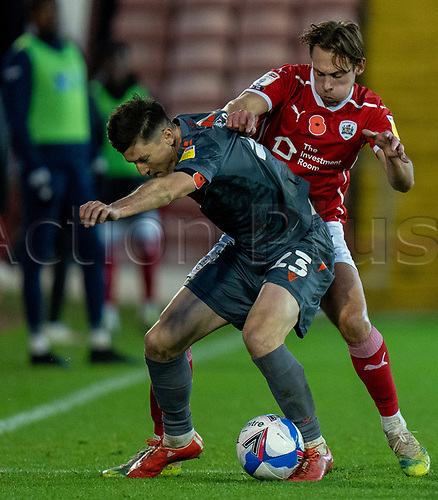 21st November 2020, Oakwell Stadium, Barnsley, Yorkshire, England; English Football League Championship Football, Barnsley FC versus Nottingham Forest; Joe Lolley of Nottingham Forrest shielding the ball from Jordan Williams of Barnsley