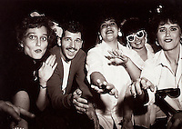 Vintage photograph of men and women having fun at a sock hop.