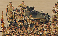 BNPS.co.uk (01202 558833)<br /> Pic: DNW/BNPS<br /> <br /> Pictured: Corporal Tony Currie led his team forward against 20 enemy gunmen during a prolonged firefight.<br /> <br /> A hero Iraq War veteran who led a full-frontal assault against 20 enemy gunmen has sold his bravery medals for £15,000.<br /> <br /> Corporal Tony Currie was part of a small force which came under heavy machine gun fire near the Al Uzayr security base in the Maysan Province in 2003. They were shot at from five different positions as they advanced through narrow streets.<br /> <br /> During the assault, an Iraqi gunman appeared suddenly in front of the British to stall the attack.