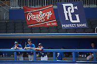 Members of the Royal Blue team watch from the dugout during the Atlantic Coast Prospect Showcase hosted by Perfect Game at Truist Point on August 22, 2020 in High Point, NC. (Brian Westerholt/Four Seam Images)