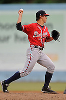 Rome Braves starting pitcher Lucas Sims #26 attempts a pickoff  during game against the Asheville Tourists  at McCormick Field on June 5, 2013 in Asheville, North Carolina. The Braves won the game 7-4. (Tony Farlow/Four Seam Images)