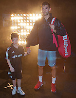 11-02-14, Netherlands,Rotterdam,Ahoy, ABNAMROWTT, Grigor Dimitrov(BUL) walk on court with an escort<br />