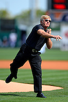 Detroit Tigers guest Jerry Glanville, a former NFL coach, throws out the first pitch before a Spring Training game against the Atlanta Braves at Joker Marchant Stadium on February 27, 2013 in Lakeland, Florida.  Atlanta defeated Detroit 5-3.  (Mike Janes/Four Seam Images)