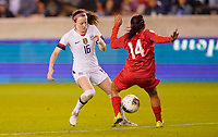 HOUSTON, TX - JANUARY 31: Rose Lavelle #16 of the United States battles with Maryorie Perez #14 of Panama for a ball during a game between Panama and USWNT at BBVA Stadium on January 31, 2020 in Houston, Texas.