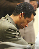 Convicted sniper John Allen Muhammad looks down at the start of the fourth day of the penalty phase of his trial in courtroom 10 at the Virginia Beach Circuit Court in Virginia Beach, Virginia on November 20, 2003.<br /> Credit: Lawrence Jackson - Pool via CNP