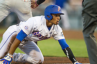 Florida Gators shortstop Richie Martin (12) is safe at third against the Miami Hurricanes in the NCAA College World Series on June 13, 2015 at TD Ameritrade Park in Omaha, Nebraska. Florida defeated Miami 15-3. (Andrew Woolley/Four Seam Images)