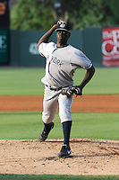 Pitcher Rafael De Paula (37) of the Charleston RiverDogs in a game against the Greenville Drive on Wednesday, June 12, 2013, at Fluor Field at the West End in Greenville, South Carolina. De Paula, a free agent from the Dominican Republic, threw 5 innings but did not figure in the decision as Charleston won, 10-5. De Paula did not figure in the decision. (Tom Priddy/Four Seam Images)