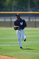 New York Yankees Jordan Scott (34) jogs back to the dugout during a minor league Spring Training game against the Detroit Tigers on March 22, 2017 at the Yankees Complex in Tampa, Florida.  (Mike Janes/Four Seam Images)