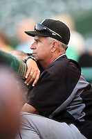 Dayton Dragons pitching coach Tony Fossas (36) during a game against the South Bend Silver Hawks on August 20, 2014 at Four Winds Field in South Bend, Indiana.  Dayton defeated South Bend 5-3.  (Mike Janes/Four Seam Images)