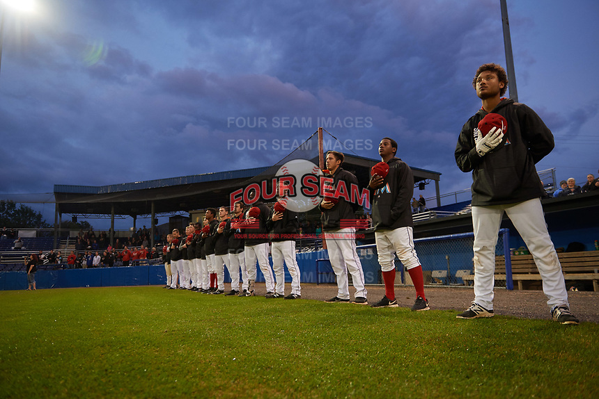 Batavia Muckdogs players and staff line up for the national anthem before a game against the Auburn Doubledays on September 6, 2017 at Dwyer Stadium in Batavia, New York.  Auburn defeated Batavia 6-3.  L-R:  General Manager Travis Sick, manager Mike Jacobs, pitching coach Jason Erickson, coach T.J. Gamba, hitting coach Rigoberto Silverio, Bubba Hollins, Brayan Hernandez, Mathew Brooks, Lazaro Alonso, David Gauntt, Osman Gutierrez, Samuel Castro, and Ricardo Cespedes.  (Mike Janes/Four Seam Images)