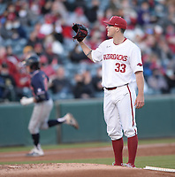 Arkansas starter Patrick Wicklander receives a new baseball from the plate Thursday, April 1, 2021, as Auburn second baseman Brody Moore circles the bases after hitting a solo home run during the third inning of play against Auburn at Baum-Walker Stadium in Fayetteville. Visit nwaonline.com/210402Daily/ for today's photo gallery. <br /> (NWA Democrat-Gazette/Andy Shupe)
