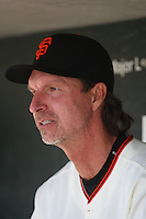 SAN FRANCISCO - OCTOBER 1:  Randy Johnson #51 of the San Francisco Giants sits in the dugout against the Arizona Diamondbacks during the game at AT&T Park on October 1, 2009 in San Francisco, California. Photo by Brad Mangin