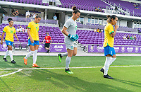 ORLANDO, FL - FEBRUARY 18: Aline #12 and Marta #10 of Brazil walk onto the field before a game between Argentina and Brazil at Exploria Stadium on February 18, 2021 in Orlando, Florida.