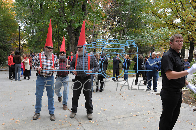 """Dressed as gnomes, buildings and grounds workers Ryan Sarkissian, left, Carson City, Jared Gloistein, Gardnerville, and David Clemensen, Carson City enjoy #NevadaSings!, a statewide sing-a-long of """"Home Means Nevada."""" Approximately 370 people took part  Thursday, Oct. 30, 2014 in the Carson City portion of the event, which seeks to establish a new record for the most people in an American state to sing their state song at the same time."""