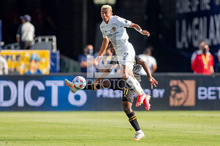 CARSON, CA - MAY 8: Julian Araujo #22 of the Los Angeles Galaxy heads a ball during a game between Los Angeles FC and Los Angeles Galaxy at Dignity Health Sports Park on May 8, 2021 in Carson, California.
