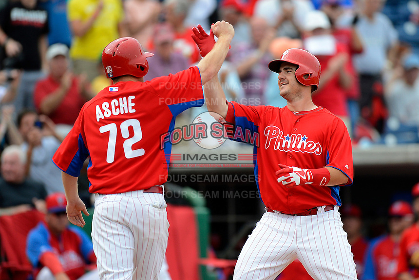 Philadelphia Phillies catcher Tommy Joseph #73 is greeted at home by third baseman Cody Asche #72 after Joseph hit a home run during a Spring Training game against the New York Yankees at Bright House Field on February 26, 2013 in Clearwater, Florida.  Philadelphia defeated New York 4-3.  (Mike Janes/Four Seam Images)