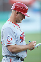 Hagerstown Suns manager Patrick Anderson (22) makes notes as he coaches third base during the game against the Greensboro Grasshoppers at First National Bank Field on April 6, 2019 in Greensboro, North Carolina. The Suns defeated the Grasshoppers 6-5. (Brian Westerholt/Four Seam Images)
