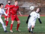 WINSTED CT. - 17 November 2020-111720SV06-#7 Keaton Terrall of Housatonic tries to control the ball as #7 Cody Millard of Northwestern defends during Berkshire League boy's soccer tournament action in Winsted Tuesday.<br /> Steven Valenti Republican-American