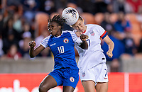 HOUSTON, TX - JANUARY 28: Nerilia Mondesir #10 of Haiti goes up for a header with Abby Dahlkemper #7 of the United States during a game between Haiti and USWNT at BBVA Stadium on January 28, 2020 in Houston, Texas.