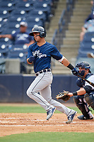 Lakeland Flying Tigers second baseman Anthony Pereira (9) follows through on a swing in front of catcher Keith Skinner (10) during a game against the Tampa Tarpons on April 8, 2018 at George M. Steinbrenner Field in Tampa, Florida.  Lakeland defeated Tampa 3-1.  (Mike Janes/Four Seam Images)