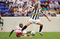 Tony Tchani (23) of the New York Red Bulls tackles the ball from Antonio Candreva (26) of Juventus F. C. The New York Red Bulls defeated Juventus F. C. 3-1 during a friendly at Red Bull Arena in Harrison, NJ, on May 23, 2010.