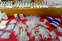 "COPY BY TOM BEDFORD<br /> Pictured: Bridal accessories, jewellery and shoes on display at the John Pye Auctions warehouse in Pyle, south Wales, UK.<br /> Re: A bride cried tears of joy after her missing wedding dress was found among a pile of 20,000 gowns in a warehouse.<br /> Meg Stamp, 27, paid £1,300 for the beautiful ivory lace dress but it  was seized by liquidators after a bridal company went bust.<br /> It was boxed up along with 20,000 others and due to be sold for a knock-down price at auction.<br /> But determined Meg banged on the auctioneer door saying: ""I want my dress back"".<br /> Staff at John Pye auctioneers in Port Talbot spent three hours sifting through boxes until they finally found Meg's dream dress.COPY BY TOM BEDFORD<br /> Pictured: at the John Pye Auctions warehouse in Pyle, south Wales, UK.<br /> Re: A bride cried tears of joy after her missing wedding dress was found among a pile of 20,000 gowns in a warehouse.<br /> Meg Stamp, 27, paid £1,300 for the beautiful ivory lace dress but it  was seized by liquidators after a bridal company went bust.<br /> It was boxed up along with 20,000 others and due to be sold for a knock-down price at auction.<br /> But determined Meg banged on the auctioneer door saying: ""I want my dress back"".<br /> Staff at John Pye auctioneers in Port Talbot spent three hours sifting through boxes until they finally found Meg's dream dress."