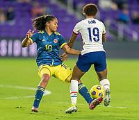 ORLANDO, FL - JANUARY 18: Gisela Robledo #10 of Colombia defends Crystal Dunn #19 of the USWNT during a game between Colombia and USWNT at Exploria Stadium on January 18, 2021 in Orlando, Florida.