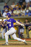 LSU Tigers shortstop Alex Bregman #8 follows through on his swing during the Southeastern Conference baseball game against the Georgia Bulldogs on March 22, 2014 at Alex Box Stadium in Baton Rouge, La. The Tigers defeated the Bulldogs 2-1. (Andrew Woolley/Four Seam Images)