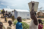 CAR, Bangui: A woman just took some water from the well where people from te Mpoko camp can take water for their garden and their laundry. 17th April 2016.<br /> RCA, Bangui : Une femme a pris un peu d'eau du puits où les gens du camp Mpoko prennent de l'eau pour leur jardin et leur linge . 17 avril 2016.