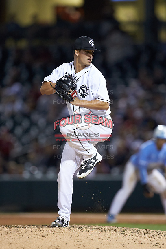 South Carolina Gamecocks relief pitcher Eddy Demurias (9) in action against the North Carolina Tar Heels at BB&T BallPark on April 3, 2018 in Charlotte, North Carolina. The Tar Heels defeated the Gamecocks 11-3. (Brian Westerholt/Four Seam Images)