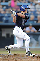 Asheville Tourists first baseman Derek Jones #8 swings at a pitch during a game against the  Kannapolis Intimidators at McCormick Field on May 9, 2013 in Asheville, North Carolina. The Intimidators won the game 13-12. (Tony Farlow/Four Seam Images).