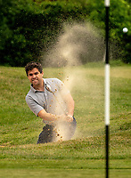 Golfer plays his shot out of the bunker. Covid-19 Golf phased exit at Hever Castle Golf club, Edenbridge, England on 17 May 2020. Photo by Liam McAvoy.<br /> <br /> Hever Castle Golf club opened its golf course on May 13, 2020 in Edenbridge, Kent.<br /> Golf courses reopen in England under government guidelines after Prime Minister Boris Johnson announced the general contours of a phased exit from the current lockdown.