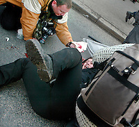 22.03.2003, Oslo Norway: .Fredrik Naumann gives first aid to protester..Anti war protest (Iraq war) started peacefully, but eventually escalated into riots and clashes with police. Photo Ida Von Hanno Bast.