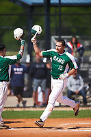 Farmingdale State Rams Dalton McCarthy (15) is congratulated by Nick Osborn (5) after hitting a home run during the first game of a doubleheader against the FDU-Florham Devils on March 15, 2017 at Lake Myrtle Park in Auburndale, Florida.  Farmingdale defeated FDU-Florham 6-3.  (Mike Janes/Four Seam Images)