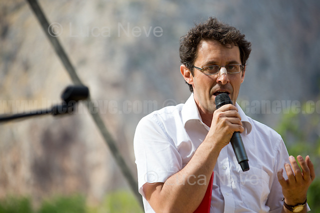"""Marco Bertelli - Memebr of Agende Rosse Momevement.<br /> <br /> Palermo (Sicily - Italy), 19/07/2017. """"Basta depistaggi e omertà di Stato!"""" (""""Stop disinformation & omertá by the State!"""")(1). Public event to commemorate the 25th Anniversary of the assassination of the anti-mafia Magistrate Paolo Borsellino along with five of his police """"scorta"""" (Escorts from the special branch of the Italian police force who protect Judges): Agostino Catalano, Emanuela Loi (The first Italian female member of the police special branch and the first woman of this branch to be killed on duty), Vincenzo Li Muli, Walter Eddie Cosina and Claudio Traina. The event was held at Via D'Amelio, the road where Borsellino was killed. Family members of mafia victims, amongst others, made speeches about their dramatic experiences, mafia violence and unpunished crimes, State cover-ups, silence ('omertá'), and misinformation. Speakers included, amongst others, Vincenzo Agostino & Augusta Schiera, Salvatore & Cristina Catalano, Graziella Accetta, Massimo Sole, Paola Caccia, Luciano Traina, Angela Manca, Stefano Mormile, Ferdinando Imposimato, Judge Nino Di Matteo. The event ended with the screening of the RAI docu-fiction, 'Adesso Tocca A Me' ('Now it's My Turn' - Watch it here: http://bit.ly/2w3WJUX ).<br /> <br /> For more info & a video of the event please click here: http://bit.ly/2eQfNT3 & http://bit.ly/2eQbmrj & http://19luglio1992.com & http://bit.ly/2he8hCj<br /> <br /> (1) 'Omerta' is the term used in Italy to refer to the code of silence used by mafia organisations, as well as the culture of silence that is entrenched in society at large (especially among victims of mafia crimes, as they fear recriminations), about the existence of organised crime and its activities."""