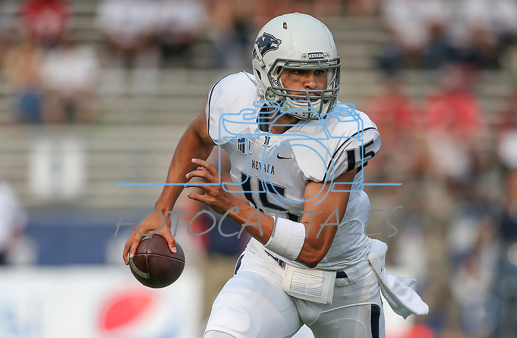 Nevada quarterback Tyler Stewart (15) scrambles against Arizona during the first half of an NCAA college football game in Reno, Nev. on Saturday, Sept. 12, 2015. (AP Photo/Cathleen Allison)