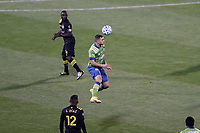 COLUMBUS, OH - DECEMBER 12: Jordan Morris #13 of the Seattle Sounders FC heads the ball during a game between Seattle Sounders FC and Columbus Crew at MAPFRE Stadium on December 12, 2020 in Columbus, Ohio.