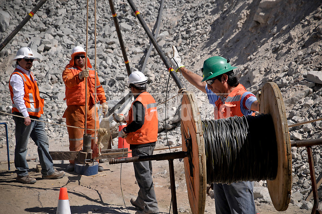 With the presence of Chile's Mining Minister Laurence Golborne the rescue team sets a tube that will be used for sending supplies to miners trapped in a deep underground copper and gold mine at Copiapo, North of Chile, where 33 miners are trapped inside a tunnel since August 5th.