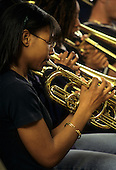 MR / Schenectady, New York. John Sayles School of Fine Arts at Schenectady High School (arts school within a school at an urban public high school). Girl (16, African-American) plays trumpet with other students at jazz band rehearsal. MR: Dau1. © Ellen B. Senisi