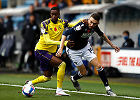 31st October 2020; The Den, Bermondsey, London, England; English Championship Football, Millwall Football Club versus Huddersfield Town; Adama Diakhaby of Huddersfield Town challenges Scott Malone of Millwall