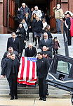 "WATERBURY CT. 31 December 2018-123118SV04-Family and friends follow pallbearers as the carry Zeqir ""Ziggy the Flag Man"" Berisha out of St. Francis Xavier Church during his funeral in Waterbury Monday. <br /> Steven Valenti Republican-American"