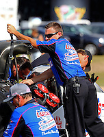 Aug 15, 2014; Brainerd, MN, USA; Crew members for NHRA top fuel dragster driver Morgan Lucas during qualifying for the Lucas Oil Nationals at Brainerd International Raceway. Mandatory Credit: Mark J. Rebilas-