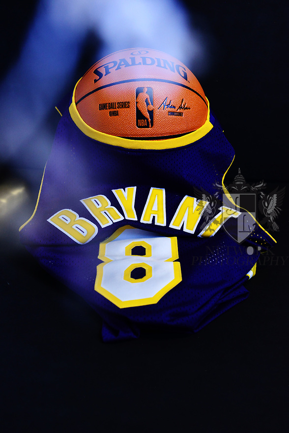 MIRAMAR, FLORIDA - JANUARY 27: (EXCLUSIVE) Kobe Bryant #8 Lakers Jersey photograph draping over a Spalding NBA basketball with a white halo. Nine people were killed in the helicopter crash which claimed the life of NBA star Kobe Bryant and his 13 year old daughter Gianna Maria-Onore Bryant, on January 26, 2020. Los Angeles officials confirmed on Sunday. Los Angeles County Sheriff Alex Villanueva said eight passengers and the pilot of the aircraft died in the accident. The helicopter crashed in foggy weather in the Los Angeles suburb of Calabasas. Authorities said firefighters received a call shortly at 9:47 am about the crash, which caused a brush fire on a hillside. in Miramar, Florida  ( Photo by Johnny Louis / jlnphotography.com )