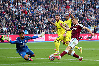 3rd October 2021;   City of London Stadium, London, England; EPL Premier League football, West Ham versus Brentford; David Raya of Brentford saves the shot by Jarrod Bowen of West Ham United