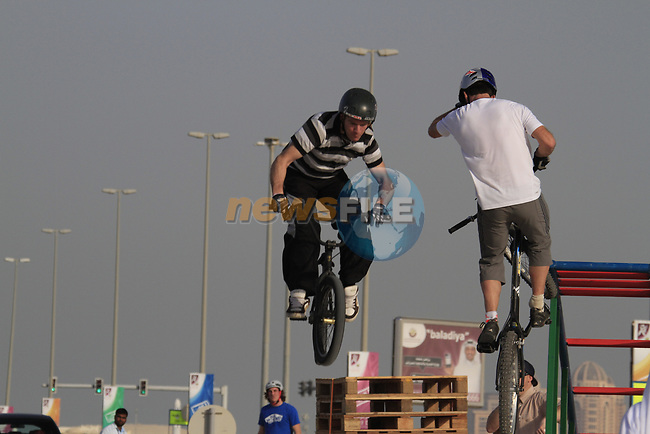 Trick riders entertain at the finish of Stage 1 of the Tour of Qatar 2012 running 142.5km from Barzan Towers to Doha Golf Club, Doha, Qatar. 5th February 2012.<br /> (Photo by Eoin Clarke/NEWSFILE).