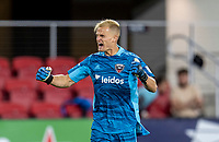 WASHINGTON, DC - MAY 13: Jon Kempin #21 of D.C. United celebrates after a game between Chicago Fire FC and D.C. United at Audi FIeld on May 13, 2021 in Washington, DC.
